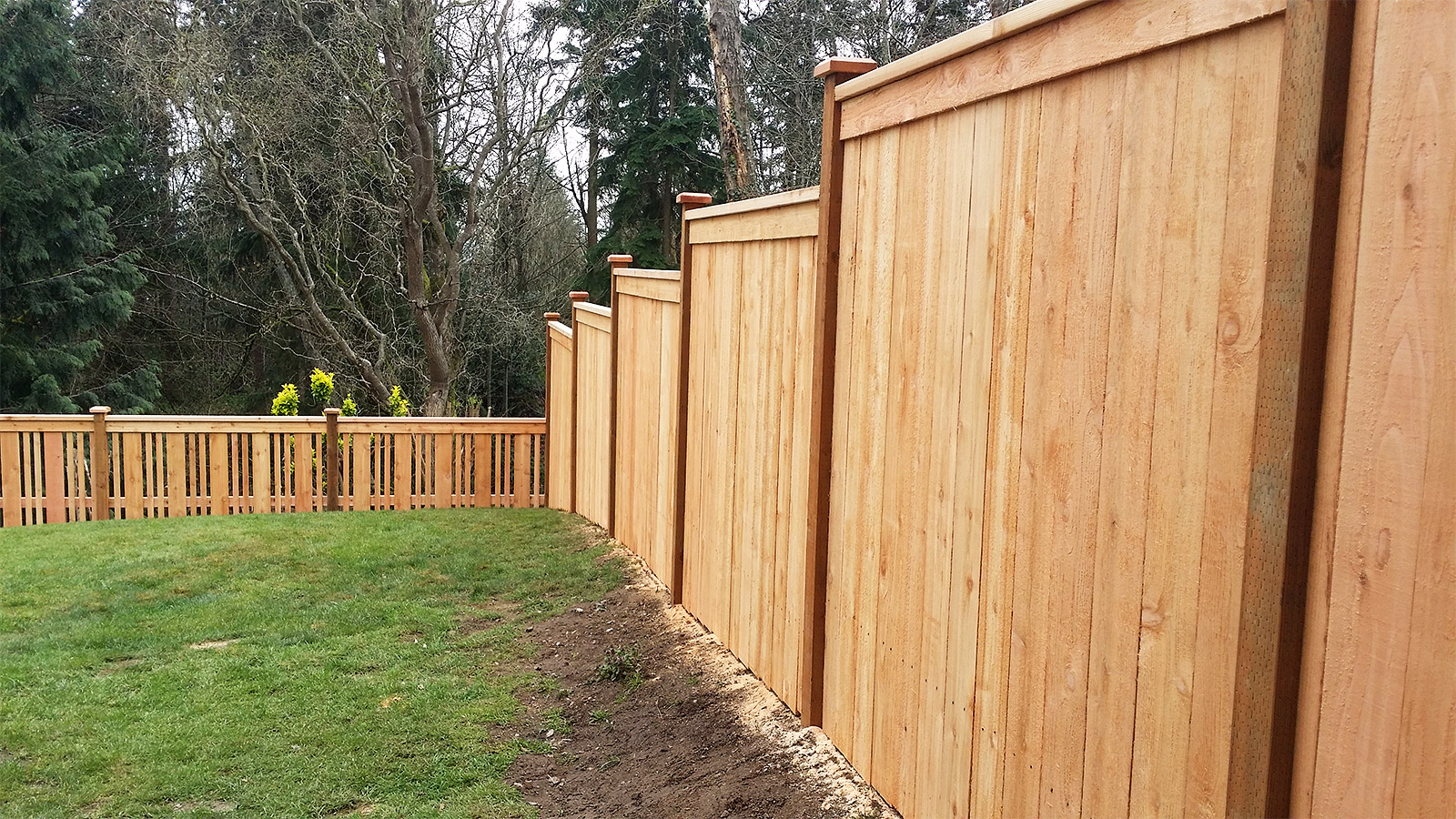 Cedar Panel Fence with Step Down Design